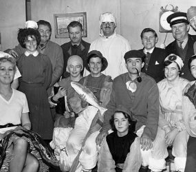 Cast in costumes including as surgeons