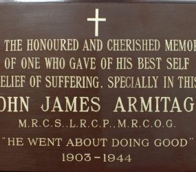 Brown wooden plaque recognising Dr Armitage's service to hospital 1903-1944