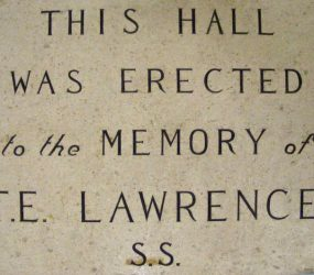 Plaque with wording dedicating outpatients hall to memory of T E Lawrence