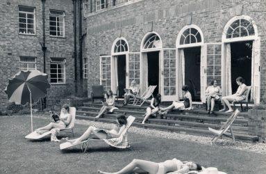 Nurses sunbathing on steps of Victoria Home