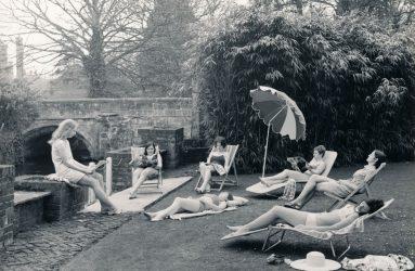Nurses sunbathe on grass outside Victoria Home