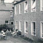 Nurses sitting outside Harcourt House