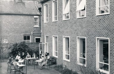 Nurses sitting outside Harcourt House