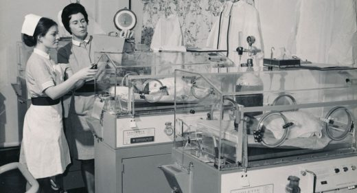 Staff midwife with student and babies in incubators