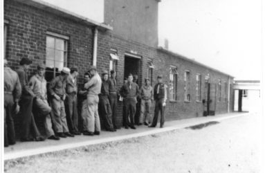 soldiers lined up against wall of mess hall