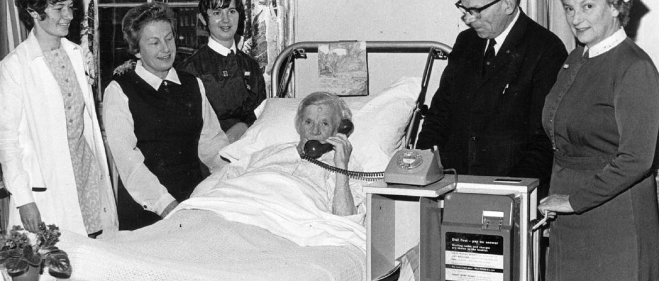 Chairman Ray Annetts with patient in bed using the new telephone