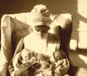 Nurse holds the triplets