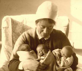 Nurse holds the triplets