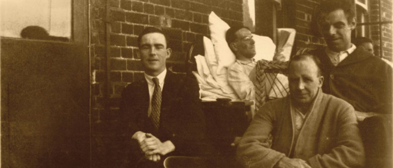 Patients sat outside on the balcony