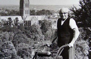 Gardener mowing lawn at Harnwood