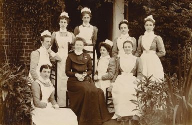 Sister and nurses posing for photo