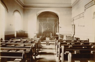 Pews in sparsely decorated chapel