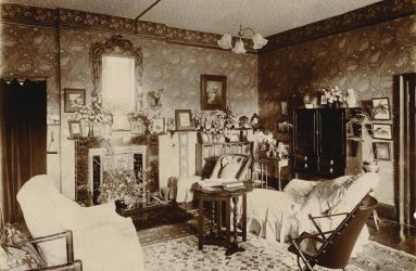Elaborately furnished Victorian sitting room with fireplace