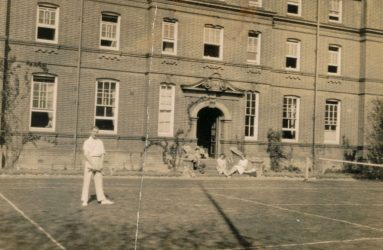 Dr Bernard Alexander playing tennis on courts outside Victoria Nurses Home, 1928