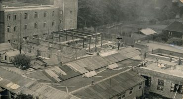 Hospital viewed from roof,showing temporary hutted buildings
