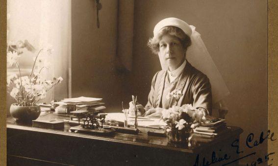 Adeline sat at writing desk