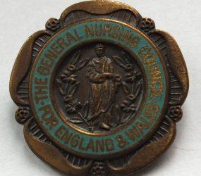 English rose shaped metal badge