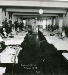 Patient sitting up in bed, ward decorated