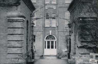 View of high stone walled entrance to hospital