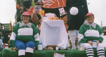 Decorated float with staff dressed as Alice in Wonderland characters