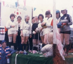 Staff on float dressed in football kit holding balls