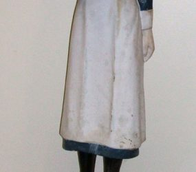 Model of nurse in 1930s uniform with collecting tin