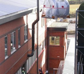 MRI scanner being lowered down the side of the hospital building