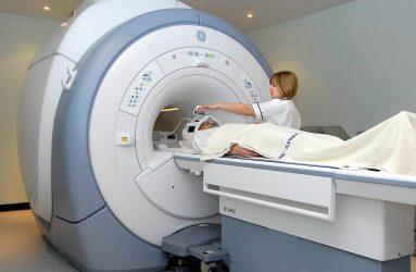 nurse next to patients preparing to enter MRI scanner