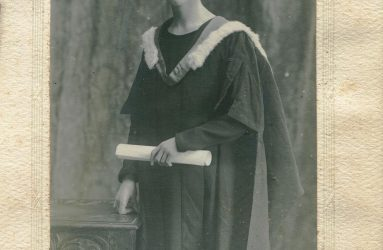 Dr Walker in graduation gown and mortar board