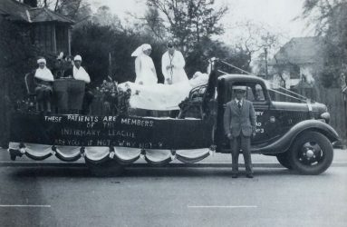 Float with patient in bed and two in chairs being treated by doctor and nurse on the back of truck