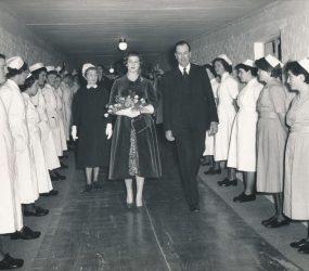 Princess Alexandra walking down hospital corridor, nurses lined up either side