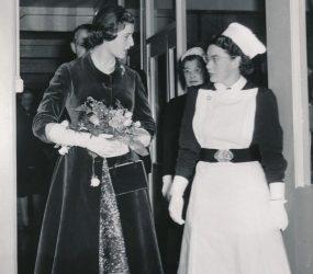 Princess to talking to matron whilst walking along corridor
