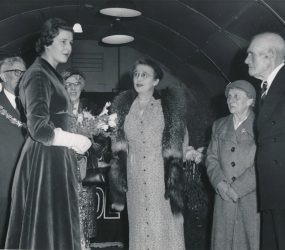 Princess Alexandra inside Nissen hut with dignitaries