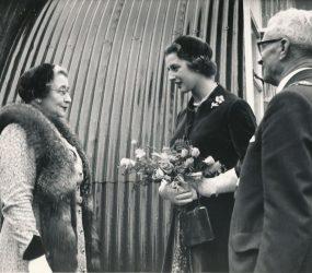 Princess Alexandra with Mayor outside Nissen Hut