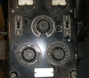 close up of dials on machine for power, voltage etc