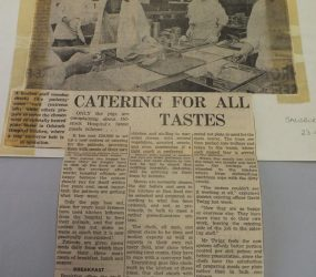 photo showing catering staff alongside new conveyer belt with article
