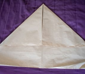 fold top corners to middle to make a triangle