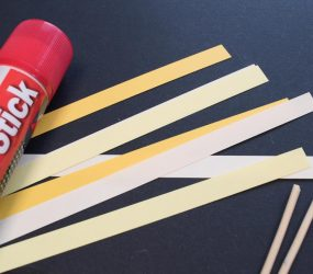 thin strips of paper in various shades of yellow