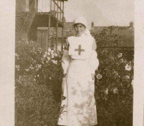 Nurse in uniform standing in the garden