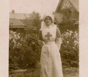 Nurse posed in hospital garden