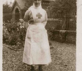 Nurse stands for photo in hospital garden