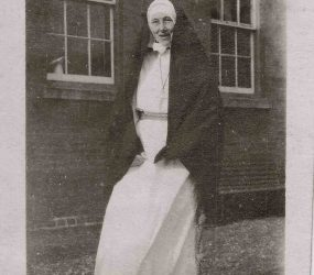 Sister poses in her nun's uniform