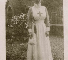 Nurse in uniform, photos shows church behind her