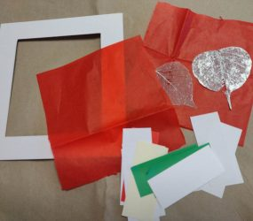 mount, red tissue paper, strips of plain paper, sheer fabric leaf shapes