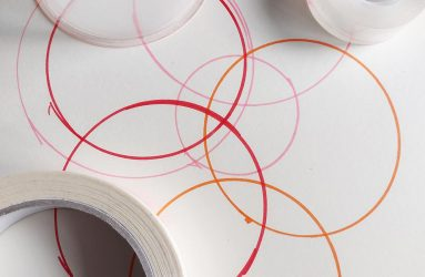 overlapping circles drawn from sellotape reels and pots