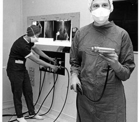 theatre staff demonstrate equipment, x-ray viewer on wall in background