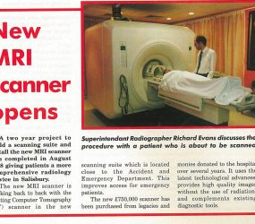 Radiographer stands by patient about to enter new MRI scanner