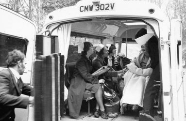 Patient in back of ambulance with nurses