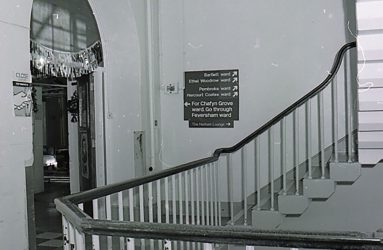 banister rail, staircase and ward signage
