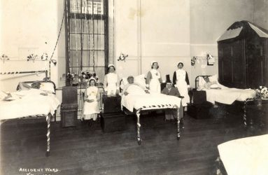Patients and nurses on ward with ribbon decoration around bed frames